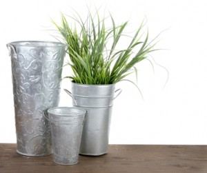 Metal gardening containers with grass